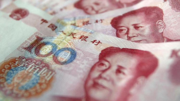 اليوان الصيني يغلق عند أدنى مستوى في أكثر من 21 شهرا