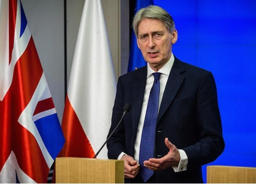 وزير الخزانة البريطاني يبدي استعداده للتصويت لإسقاط بوريس جونسون