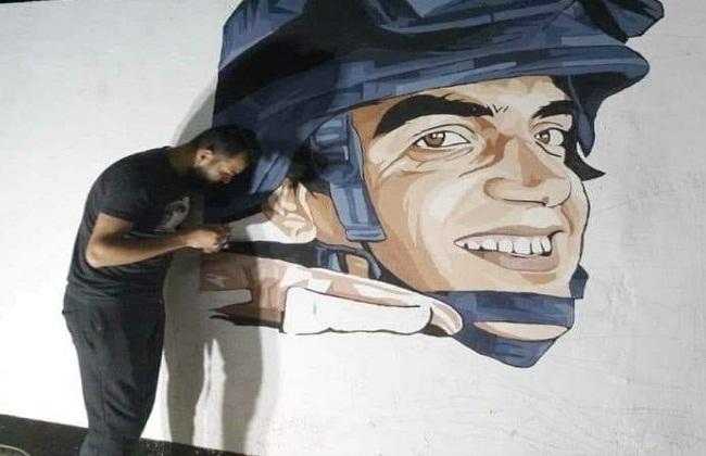 """تجميل مدخل قرية """"شبرا ملكان"""" بجدارية لصورة الشهيد أحمد المنسي"""