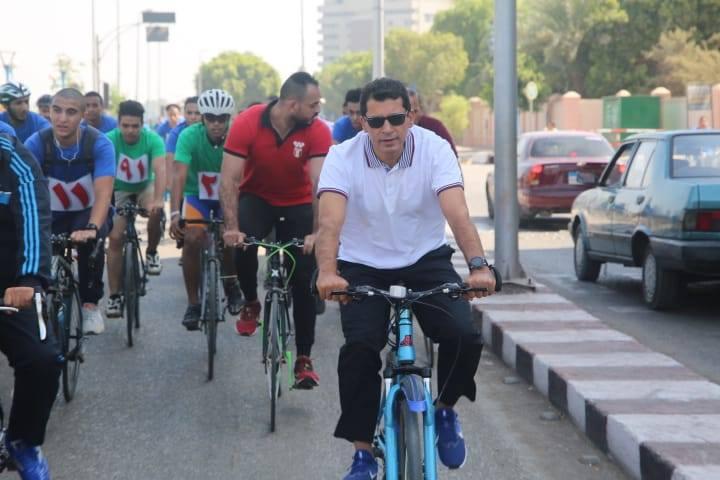 صور | وزير الرياضة ومحافظ أسيوط يقودان ماراثون للدراجات بشوارع أسيوط