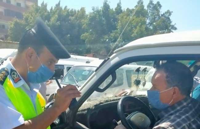 إجراءات قانونية ضد 5604 سائقين نقل جماعى بسبب الكمامة